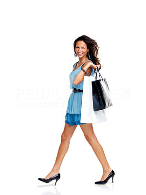 Buy stock photo Shopaholic - Young woman with lots of shopping bags walking on white background