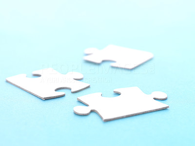 Buy stock photo Three jigsaw puzzle pieces on blue background