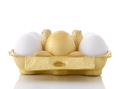 Buy stock photo Easter egg in a cardboard box among normal eggs against white background