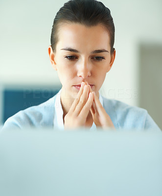 Buy stock photo Woman concentrating on laptop indoors