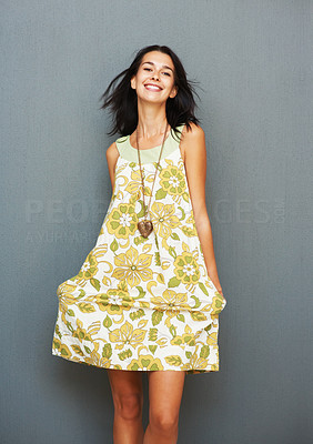 Buy stock photo Smiling woman posing by holding dress