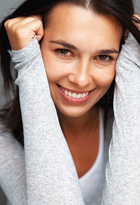 Buy stock photo Closeup of woman smiling and leaning with hands on head