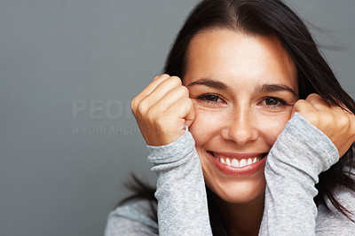 Buy stock photo Closeup of woman with face in hands smiling