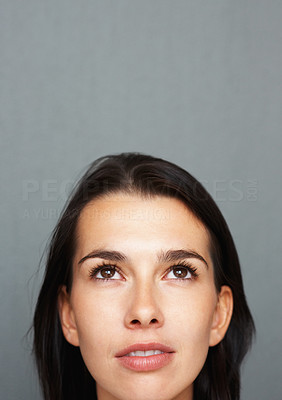 Buy stock photo Closeup of woman's face with her looking up