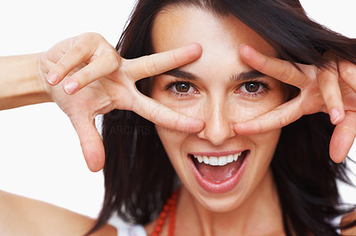 Buy stock photo Woman holding up fingers and peeking between them