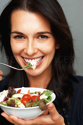 Buy stock photo Pretty woman smiling while ready to eat salad