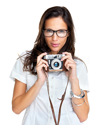 Buy stock photo Lovely young woman wearing glasses holding an old camera against white background
