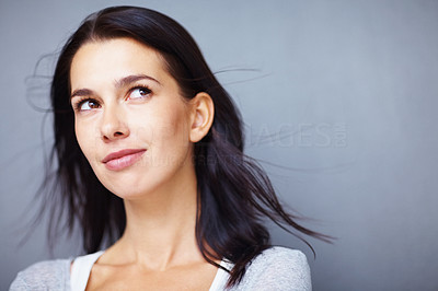 Buy stock photo Thoughtful pretty woman looking up at copyspace
