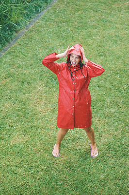 Buy stock photo Top view of pretty woman in raincoat enjoying rain at park