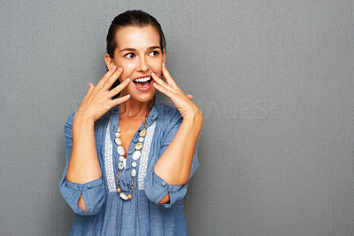 Buy stock photo Pretty young woman with surprised expression against wall