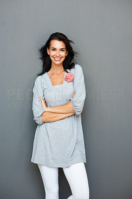 Buy stock photo Portrait of beautiful young woman standing with her hands folded