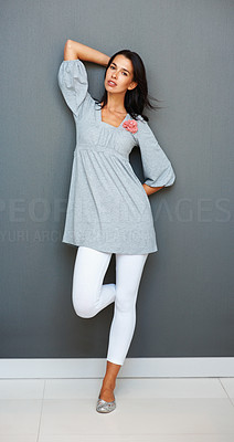 Buy stock photo Full length of pretty young woman posing against the wall