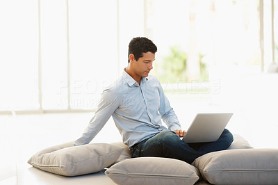 Buy stock photo Portrait of young business man using laptop while sitting on floor