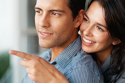Buy stock photo Closeup of happy woman showing something to her boyfriend