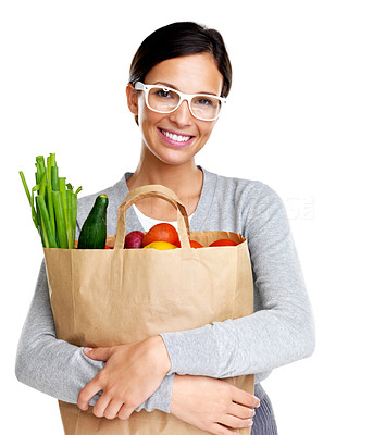 Buy stock photo Portrait of happy young woman in glasses holding grocery bag on white background