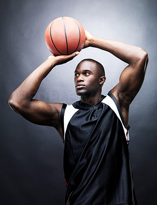 Buy stock photo Portrait of a young basketball player in action against grunge background