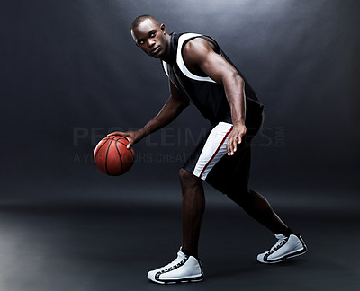 Buy stock photo Portrait of a fit young male basketball player practising against grunge background