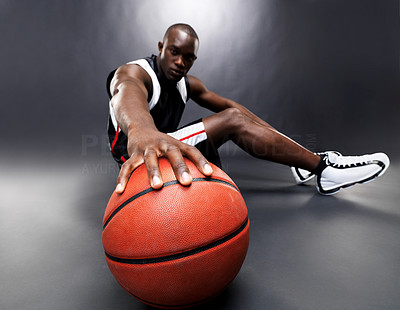 Buy stock photo Portrait of an afroamerican young male basketball player sitting against grunge background