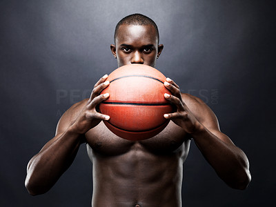Buy stock photo Portrait of a muscular young man holding a  basketball against grunge background