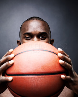 Buy stock photo Portrait of an afroamerican young man holding a basketball against grunge background