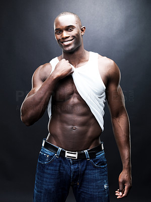 Buy stock photo Portrait of a happy young male bodybuilder showing his body against grunge background