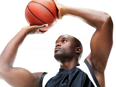 Buy stock photo A successful young male basketball player taking a free throw against a white background