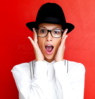 Buy stock photo Portrait of a pretty young woman looking surprised in trendy fashion, isolated against red background