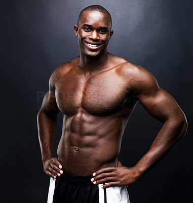Buy stock photo Portrait of a happy bodybuilder with muscular physique standing against grunge background