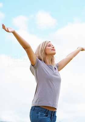 Buy stock photo Relaxed young female with hands outstretched enjoying the nature