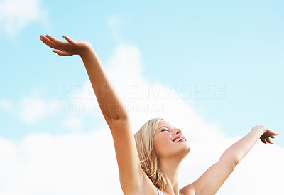 Buy stock photo Smiling attractive female relaxing with the sky