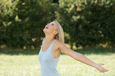 Buy stock photo Free woman with arms open having fun