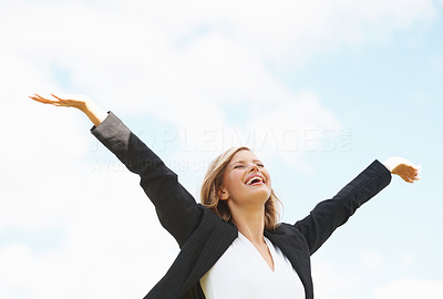 Buy stock photo Cheerful business woman with hands outstretched enjoying the nature
