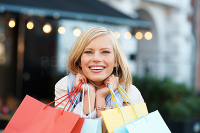 Buy stock photo Excited young woman with shopping bags