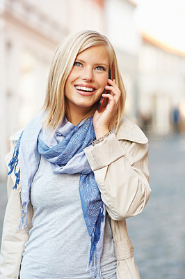 Buy stock photo Cheerful young woman using cell phone