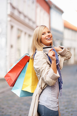 Buy stock photo Young attractive woman with shopping bags and credit card