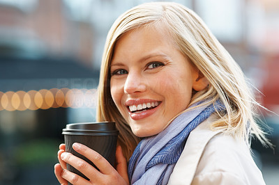 Buy stock photo Closeup of an attractive young female enjoying her coffee