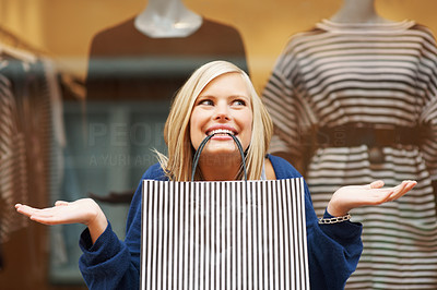 Buy stock photo Portrait of young woman with shopping bag in smiling mouth