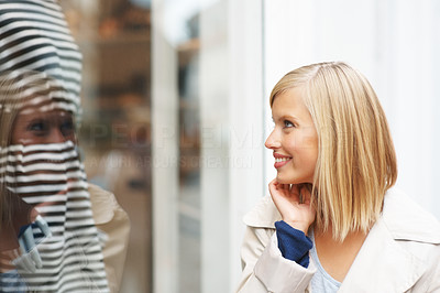 Buy stock photo Portrait of happy young woman looking at window display