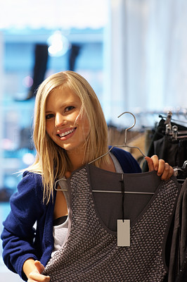 Buy stock photo Portrait of young woman trying outfit in the store