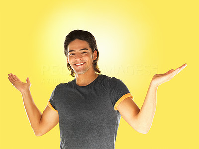 Buy stock photo Attractive man holding arms out and smiling against yellow background