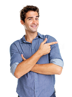 Buy stock photo Portrait of a happy young man pointing at something interesting over white background