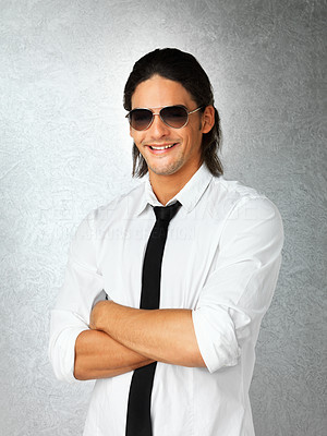 Buy stock photo Happy man with arms folded while wearing vest and sunglasses