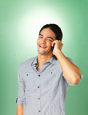 Buy stock photo Handsome man smiling while talking on phone