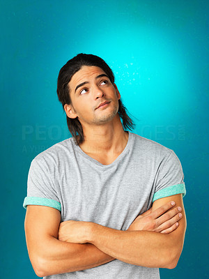 Buy stock photo Handsome man with crossed arms looking up