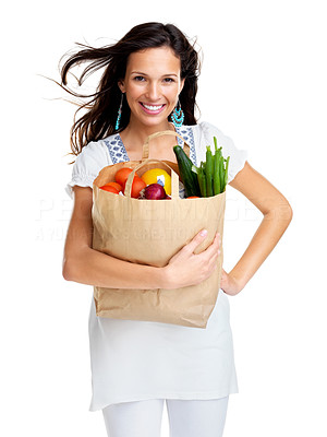 Buy stock photo Portrait of happy young woman holding a shopping bag full of groceries on white background