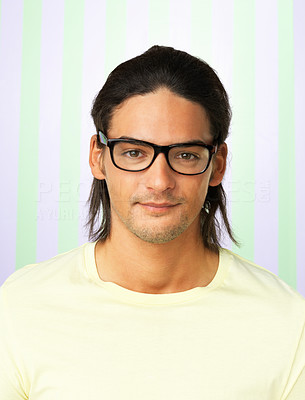 Buy stock photo Closeup of young man wearing glasses against colored background