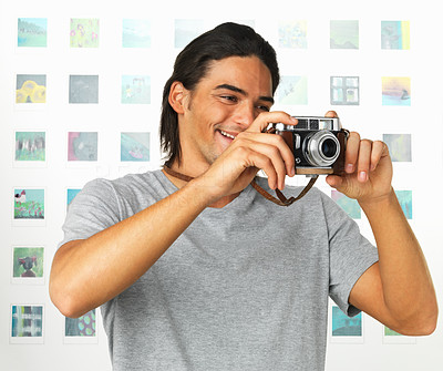 Buy stock photo Young male photographer with camera taking picture
