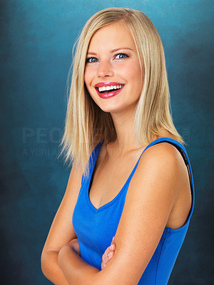 Buy stock photo Portrait of pretty woman standing with arms folded on blue background