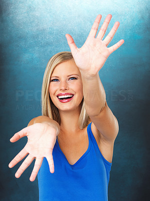 Buy stock photo Pretty woman with hands extended out