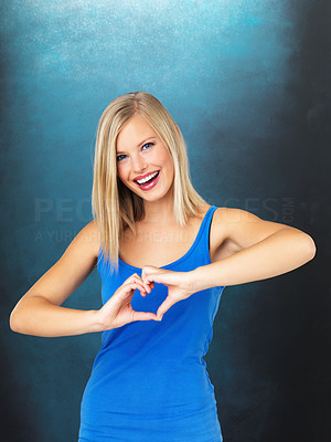 Buy stock photo Beautiful woman making heart sign over heart